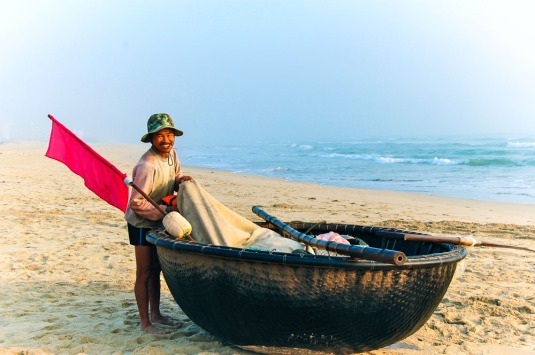 Fishing basket boat on China Beach in Danang, Vietnam