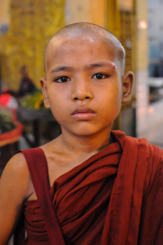 Young novice monk at Mandalay temple